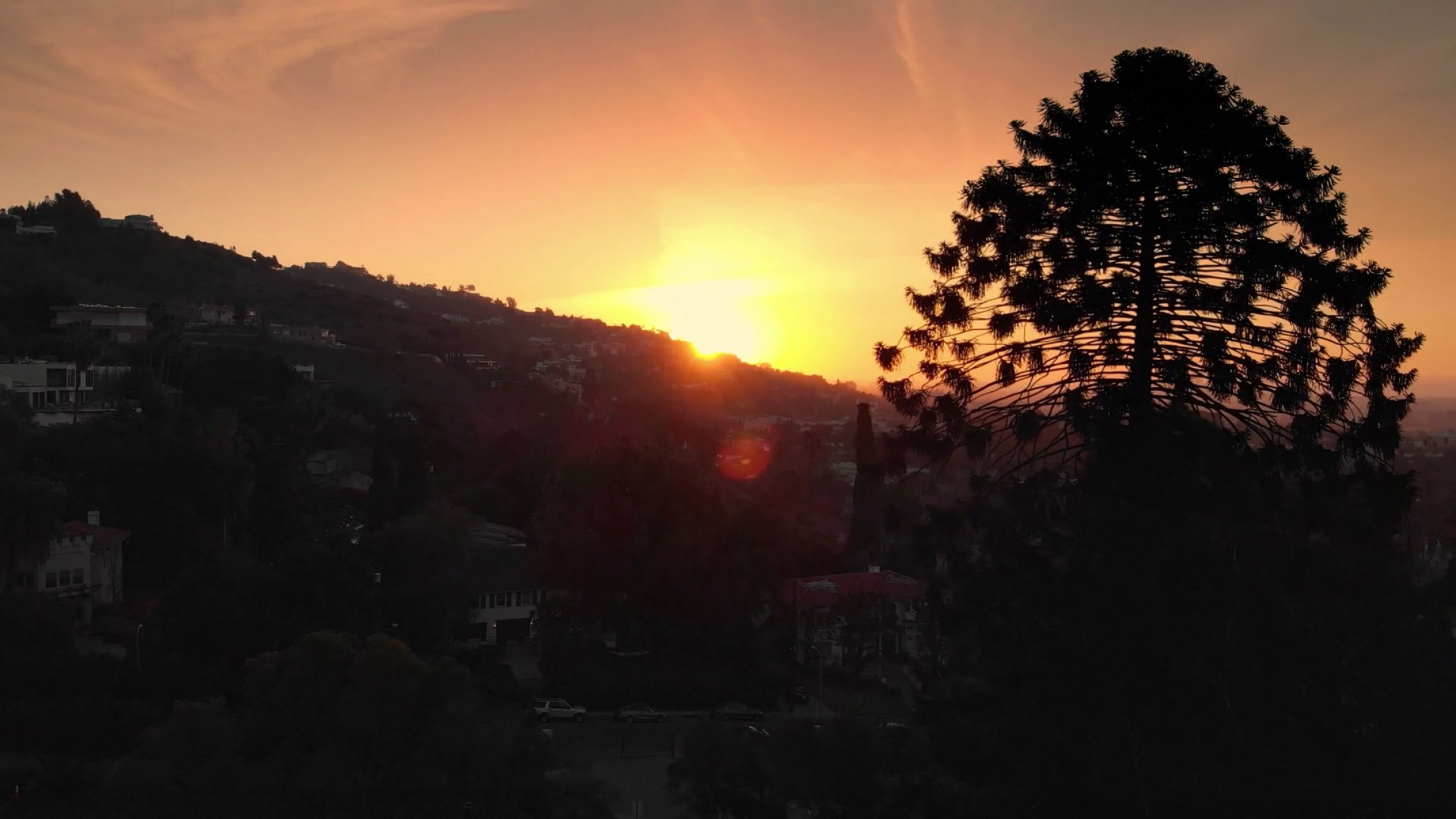 Hollywood Hills Vector: Aerial View Of Sunset Sun Peaking Over Hollywood Hills Skyline Los Angeles Cityscape In Background K Uhd H Pdtghifjdgvqee