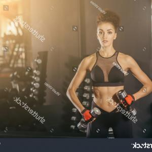 Vector Abstract Woman Bodybuilder Physique: Photostock Vector Sport Couple Man And Woman Hold Dumbbells Fitness Trainer Bodybuilder Athletic Muscle Over Colorful