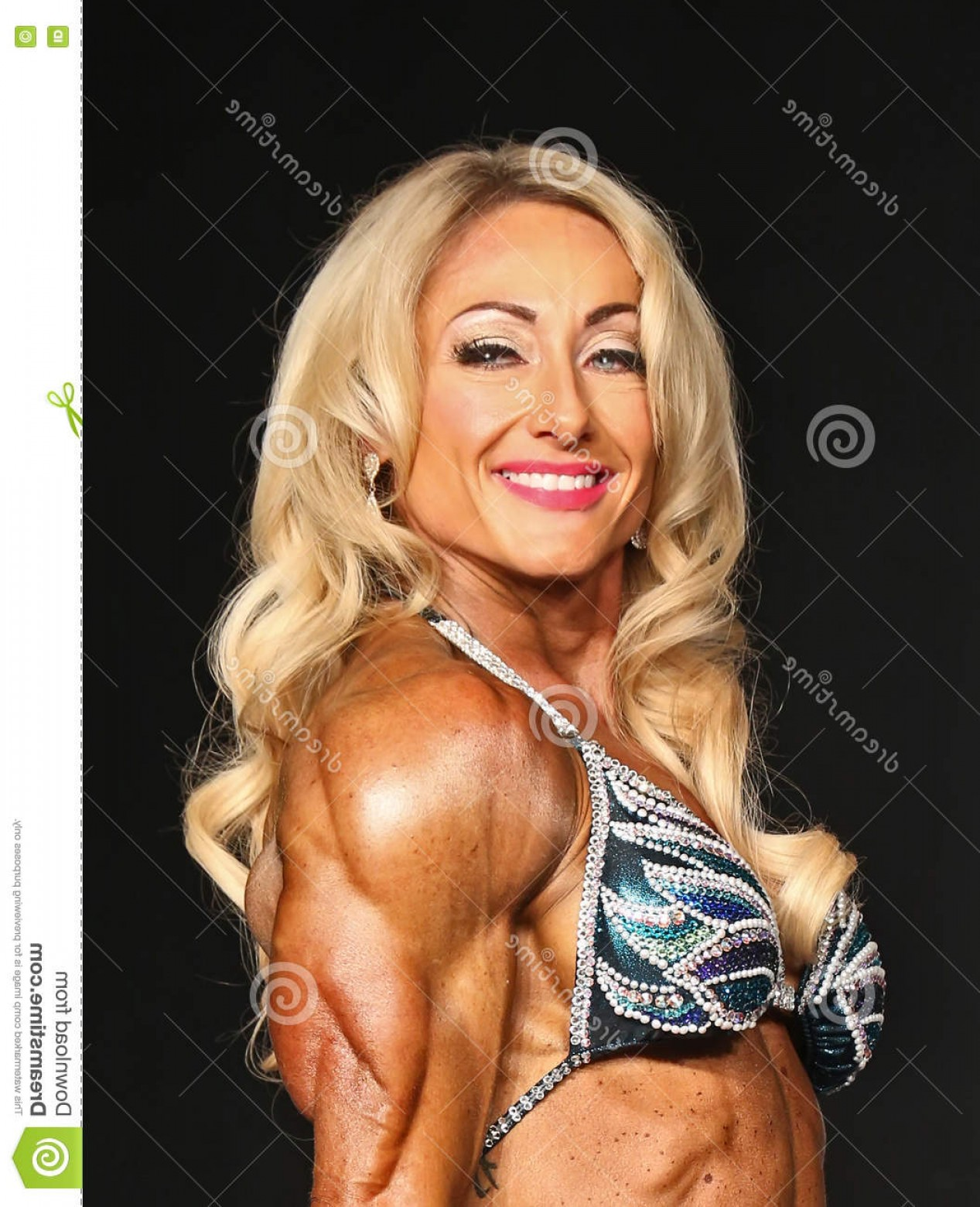 Vector Abstract Woman Bodybuilder Physique: Editorial Image Ripped Blonde Bodybuilder Beautiful Jill Diorio Flexes Powerful Defined Tricep Pose As Competes Women S Physique Image