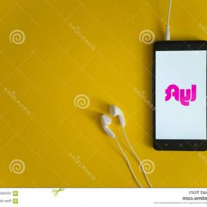 Lyft Vector Graphic: Lyft Logo Smartphone Screen Yellow Background Los Angeles Usa October Earphones Plugged Image
