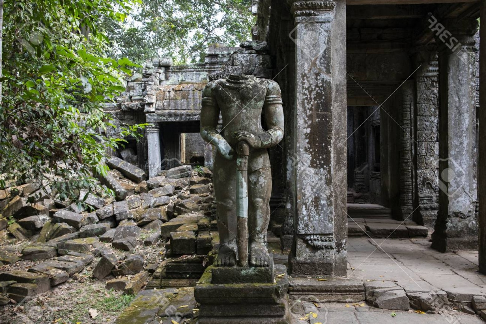 Ancient Jungle Statue Vector Images: Photoancient Ruins Of Preah Khan Temple In Angkor Wat Complex Cambodia Headless Statue Of Demolished Pala