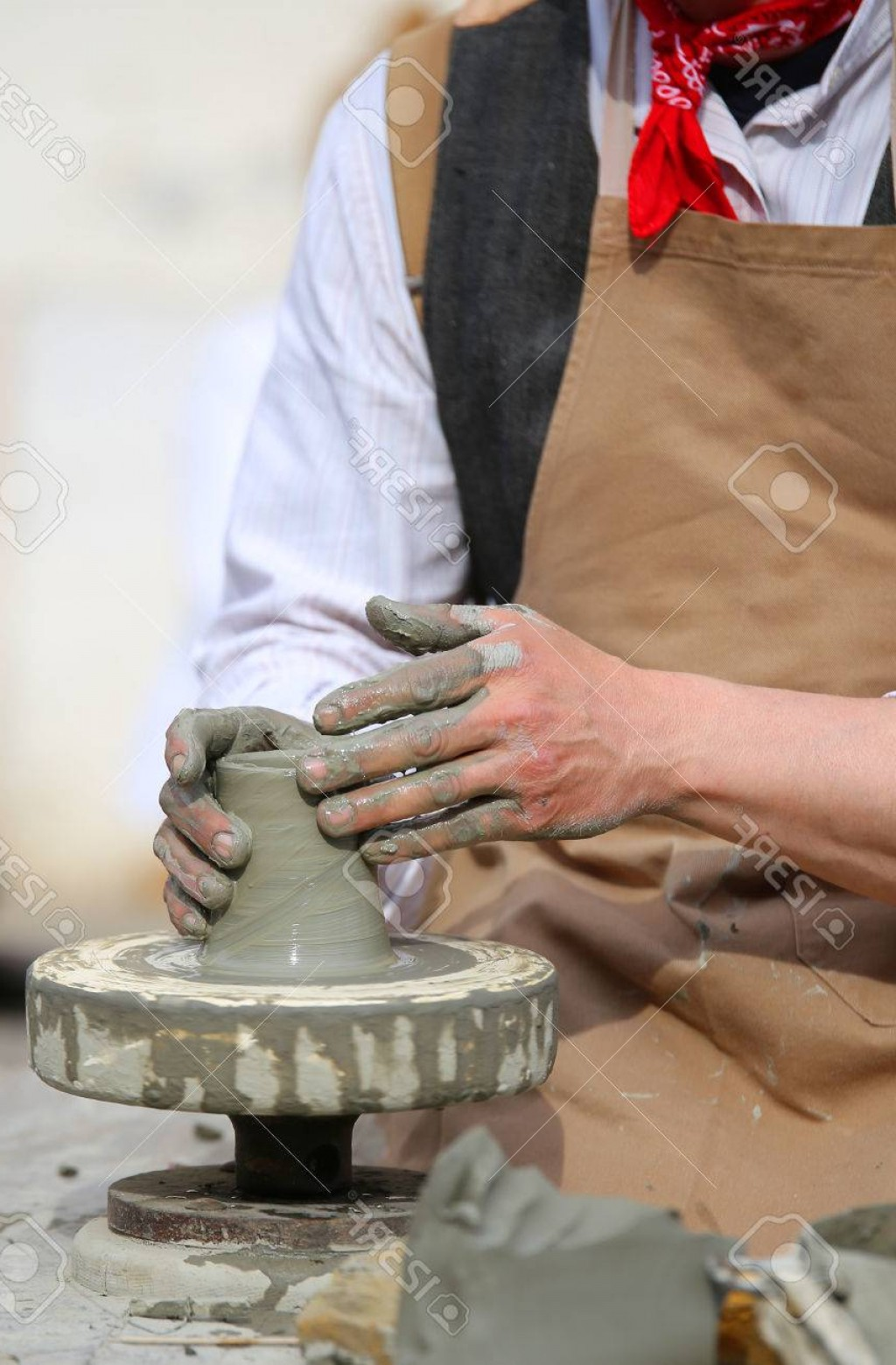 Hand Lathe Vector: Photocraftsman Potter With The Hand Lathe During Production Of A Vase