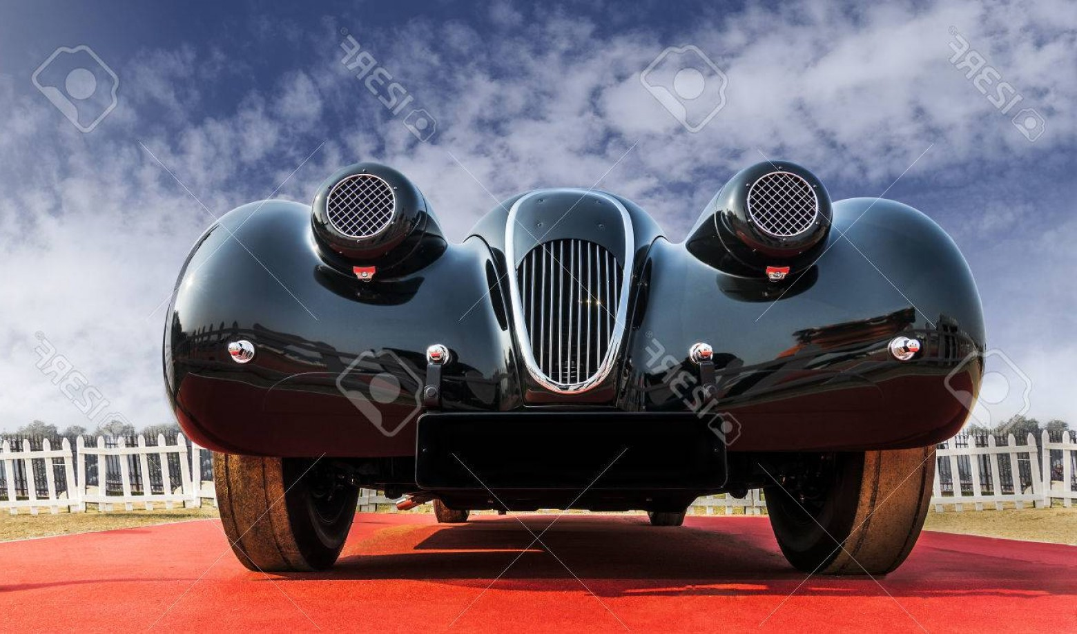 Race Car Grill Vector: Photofront Low Angle View Of An Unknown Old Timer Retro Vintage Sports Car Under Blue Cloudy Sky The Fron