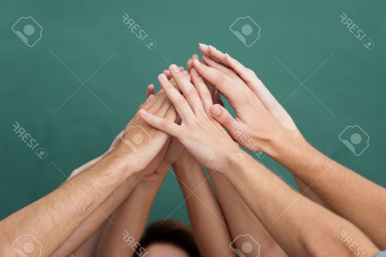 Vector Group Of Hands Overlapped: Phototeamwork And Cooperation With A Group Of Young People All Raising Their Hands Together And Forming A