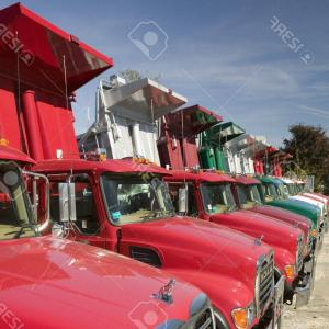 Mack Dump Truck Vector: Photobright Red Mack Dump Trucks Line The Road In A Row In Maine Near The New Hampshire Border