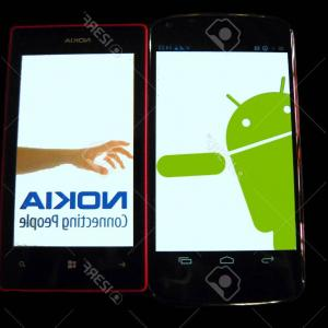 Search Logo Lumia Vector: Photonokia S Hand Logo Parody Nokia Reach Out To Android Google Nexus And Nokia Lumia On Wooden Bac