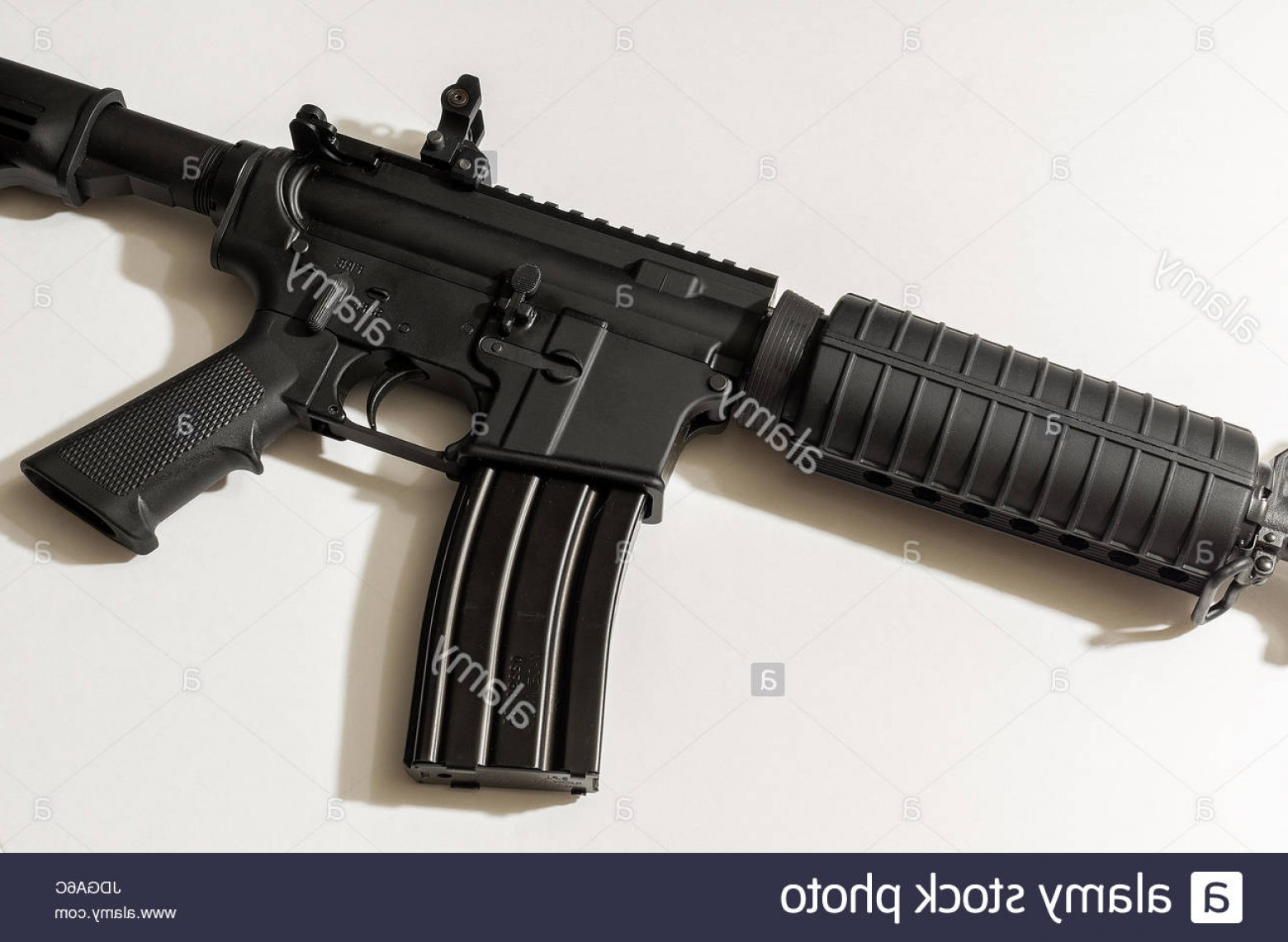 Nato Assault Rifles Vector Graphics: Stock Photo Ar Rifle Chambered In Nato Lying On A Wooden Table