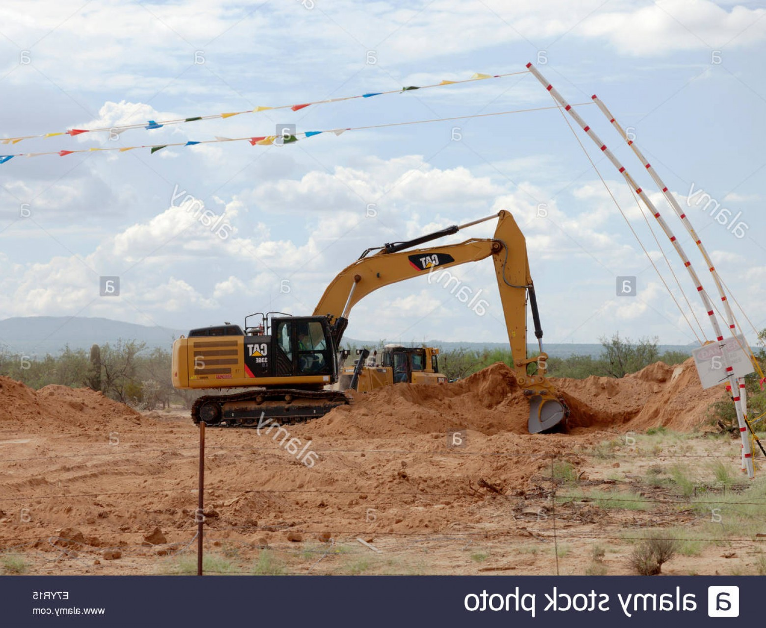 Caterpillar Trackhoe Vector: Stock Photo Caterpillar Cat E Excavator Digging Dirt Bucket Full Arizona Operator