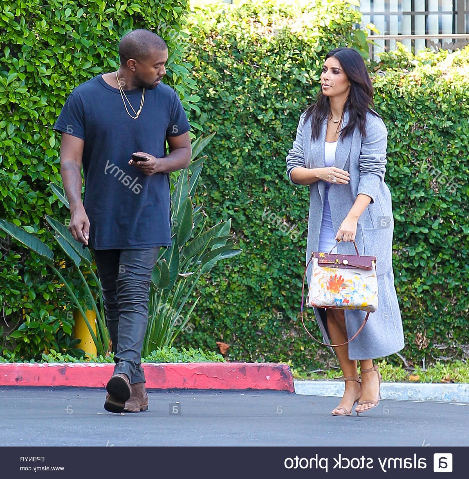 Kanye West Vector Paintig: Stock Photo Kanye West And Kim Kardashian Whos Holding An Original Hermes Bag