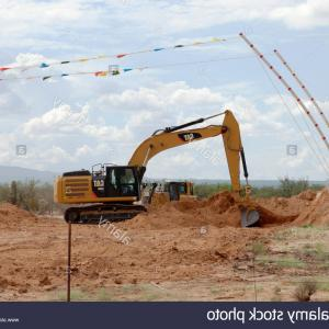 Caterpillar Trackhoe Vector: Stock Photo Digger Excavator Machinery Digging Action In Construction Site Abstract