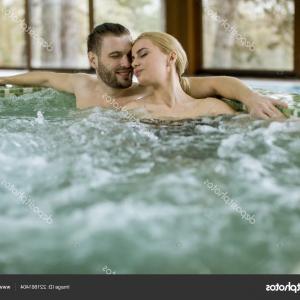 Vector Relaxing Hot Tub: Stock Photo Loving Couple Relaxing Hot Tub